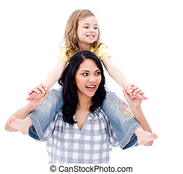 Handsome mother giving piggyback ride to her daughter ...