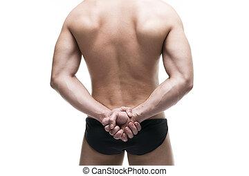 Handsome muscular bodybuilder posing on white background. Isolated studio shot