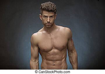 Handsome muscular guy with great hairstyle