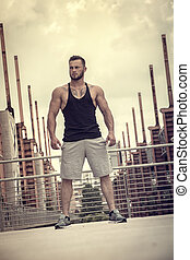 Handsome Muscular Hunk Man Outdoor in City Setting
