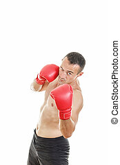 Handsome muscular male boxer ready to fight with boxing gloves
