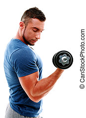 Handsome muscular man doing exercises with dumbbell