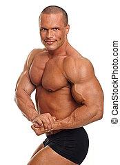Handsome muscular man in underwear posing