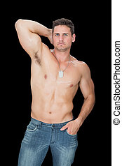 Handsome muscular man posing in blu