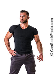 Handsome muscular man standing, isolated