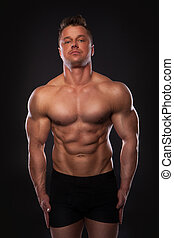 Handsome muscular man - Studio shot of handsome muscular man...