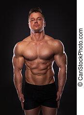 Handsome muscular man - Studio shot of handsome muscular man...