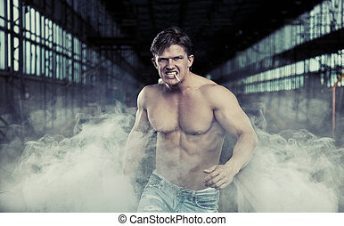 Handsome muscular man walking