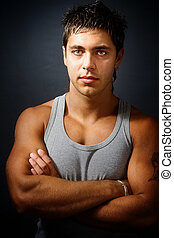Handsome muscular man with arms folded