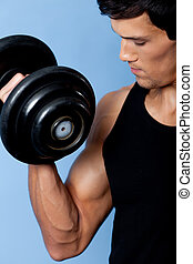 Handsome muscular man with dumbbell, close up