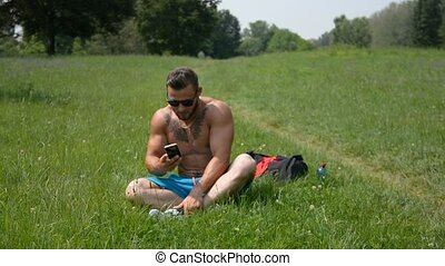 Handsome Muscular Shirtless Hunk Man Outdoor in City Park