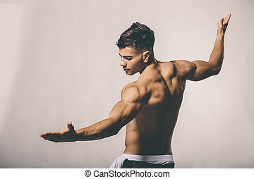 Handsome muscular young man posing in the studio
