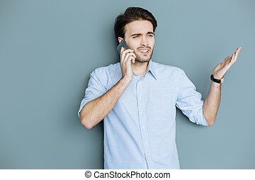 Handsome nice man gesticulating