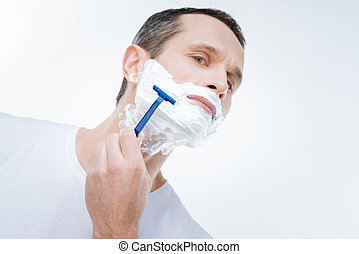 Handsome nice man holding a razor