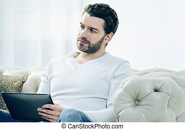 Handsome nice man resting at home