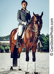 Handsome nice man wearing special uniform for riding