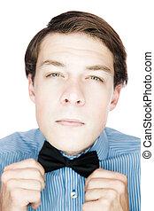 Handsome old-fashioned gentleman adjusting his bow tie