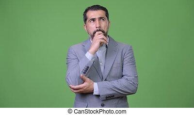Handsome Persian bearded businessman thinking - Studio shot...