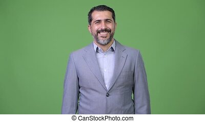 Handsome Persian bearded businessman with arms crossed