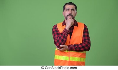 Handsome Persian bearded man construction worker thinking