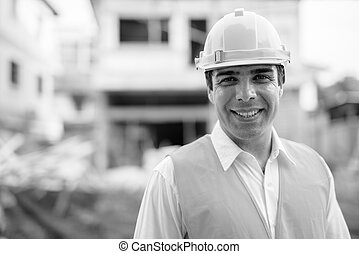 Handsome Persian man construction worker at the construction site