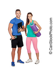 Handsome personal trainer with a attractive girl