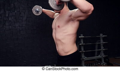 Strong bodybuilder with six pack, perfect abs, shoulders, biceps, triceps and chest