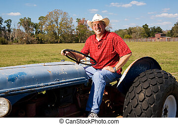Handsome Rancher - Handsome rancher rides his tractor