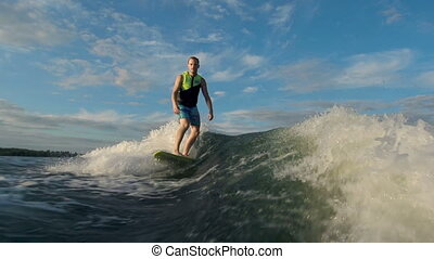 Handsome Rider - Wakesurfer approaching camera riding the...