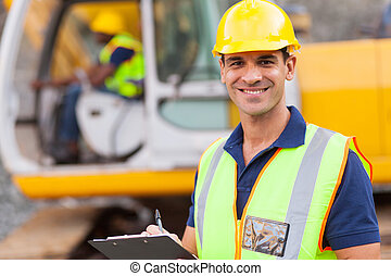 handsome road construction supervisor with clipboard
