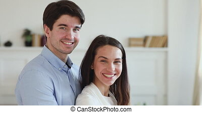 Handsome romantic man cuddling attractive smiling mixed race...