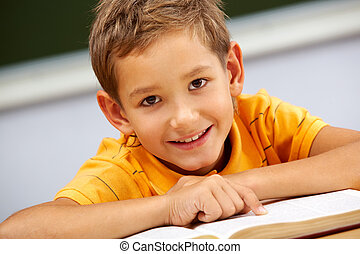 Handsome schoolkid - Portrait of smart lad looking at camera...