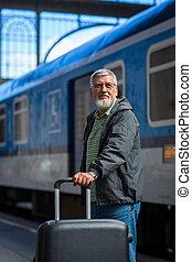 Handsome senior man taking a train