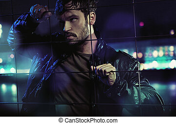 Handsome serious man trying to get out of fictious prison -...