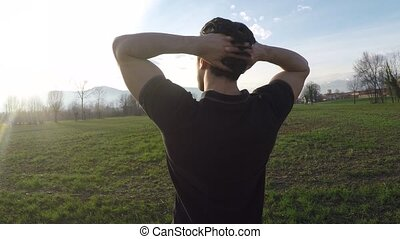 Handsome sexy man outdoors in field thinking