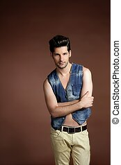 Handsome sexy young man portrait denim vest