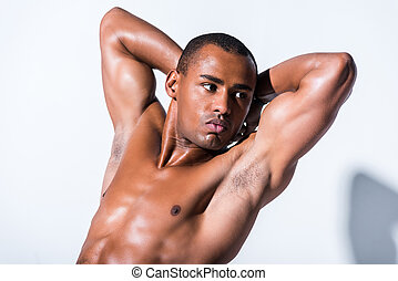handsome shirtless african american sportsman with hands behind head looking away isolated on grey