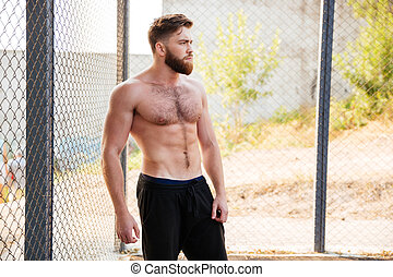 Handsome shirtless fitness man during workout outdoors - ...