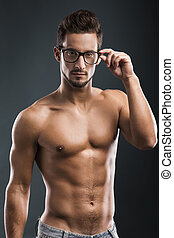 handsome shirtless male model - Shirtless male model posing...