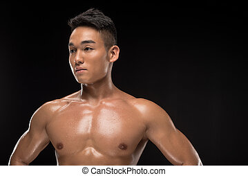 shirtless muscular asian man