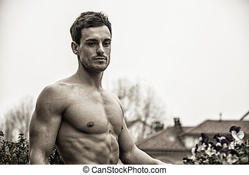 Handsome shirtless young man outdoor