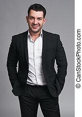 handsome smiling confident businessman