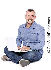 Handsome smiling guy with laptop
