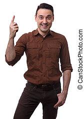 Handsome smiling man pointing upwards