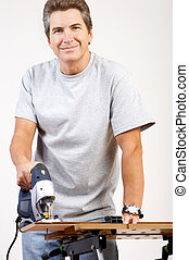 Renovation - Handsome smiling man working at home....