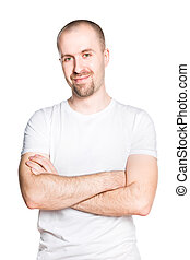 Handsome smiling young man with folded arms in white t-shirt...