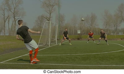 Handsome soccer player hitting ball with head - Handsome...