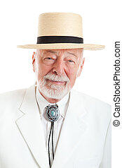 Portrait of a handsome senior man dressed in traditional Southern style.