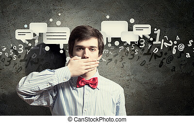 Handsome businessman closing his mouth with palms