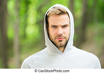 Handsome sport coach. Sportsman lifestyle. Handsome athlete in park. Wellbeing and self care. Handsome man sporty outfit look confident. Male beauty. Guy handsome bearded face well groomed bristle